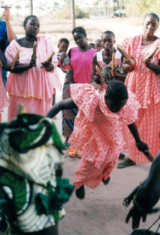Jola women dancing bukarabo during circumcission ceremony